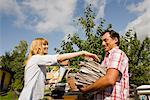 A couple recycling old newspapers, Sweden. Stock Photo - Premium Royalty-Free, Artist: Cusp and Flirt, Code: 6102-03828453