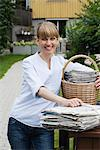 A woman recycling newspapers, Sweden. Stock Photo - Premium Royalty-Free, Artist: Multi-bits, Code: 6102-03828482