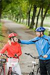 A couple cykling in a park, Sweden. Stock Photo - Premium Royalty-Free, Artist: CulturaRM, Code: 6102-03828503