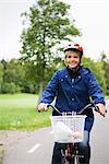 Female cyclist in a park, Stockholm, Sweden. Stock Photo - Premium Royalty-Freenull, Code: 6102-03828593