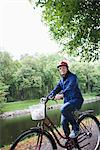 Female cyclist in a park, Stockholm, Sweden. Stock Photo - Premium Royalty-Freenull, Code: 6102-03828598