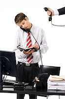 A teenage boy as a businessman at the office. Stock Photo - Premium Royalty-Freenull, Code: 6102-03828770