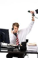 A teenage boy as a businessman at the office. Stock Photo - Premium Royalty-Freenull, Code: 6102-03828772