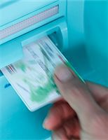 Hand pulling debit card from ATM Stock Photo - Premium Royalty-Freenull, Code: 618-03834567
