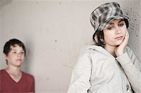 sad lovers break up - Girl and Boy Leaning on Wall Stock Photo - Premium Royalty-Freenull, Code: 600-03836165