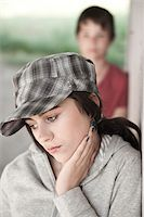 Girl and Boy Leaning on Wall Stock Photo - Premium Royalty-Freenull, Code: 600-03836166