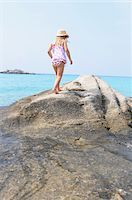 Girl Walking on Boulder at Beach Stock Photo - Premium Rights-Managednull, Code: 700-03836228