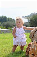 Little Girl Wearing Sundress Stock Photo - Premium Rights-Managednull, Code: 700-03836235