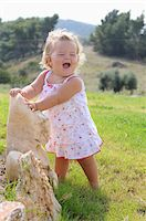 Little Girl Wearing Sundress and Laughing Stock Photo - Premium Rights-Managednull, Code: 700-03836236