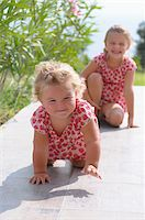 Sisters on Tiled Patio Stock Photo - Premium Rights-Managednull, Code: 700-03836237