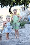 Sisters in Courtyard with Hands on Hips Stock Photo - Premium Rights-Managed, Artist: Pascal Albandopulos, Code: 700-03836241