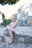 shy baby - Little Girl Sitting with Legs Crossed Stock Photo - Premium Rights-Managednull, Code: 700-03836246