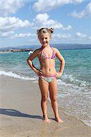 Little Girl Wearing Bikini at Beach Stock Photo - Premium Rights-Managednull, Code: 700-03836264