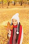 Preteen Girl With Maple Leaf Stock Photo - Premium Rights-Managed, Artist: Aflo Relax, Code: 859-03839363