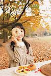 Preteen Girl Looking Trough Hole In Bagel Stock Photo - Premium Rights-Managed, Artist: Aflo Relax, Code: 859-03839423