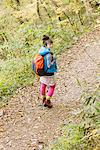 Young Woman Hiking Looking Back Stock Photo - Premium Rights-Managed, Artist: Aflo Relax, Code: 859-03839498
