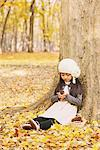 Little Girl Looking At Pine Cone Stock Photo - Premium Rights-Managed, Artist: Aflo Relax, Code: 859-03839579