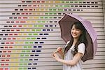 Young adult woman with umbrella Stock Photo - Premium Rights-Managed, Artist: Aflo Relax, Code: 859-03840044