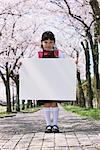Girl Holding Whiteboard Stock Photo - Premium Rights-Managed, Artist: Aflo Relax, Code: 859-03840765
