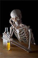 An alcoholic skeleton Stock Photo - Premium Royalty-Freenull, Code: 653-03843114