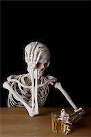 An alcoholic skeleton Stock Photo - Premium Royalty-Freenull, Code: 653-03843137
