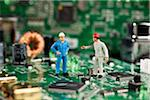 Two miniature figurine men working on a computer mother board Stock Photo - Premium Royalty-Free, Artist: Blend Images, Code: 653-03843576
