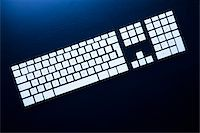 Separate computer keys arranged to look like an actual keyboard Stock Photo - Premium Royalty-Freenull, Code: 653-03843846