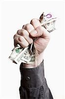 A man gripping a wad of US paper currency, close-up of hand Stock Photo - Premium Royalty-Freenull, Code: 653-03843886