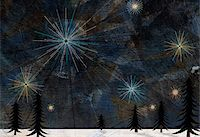 Stars glistening in the sky above pine trees and snow on the ground Stock Photo - Premium Royalty-Freenull, Code: 653-03843944