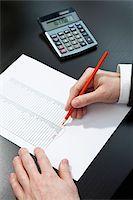 Invoice totaling Stock Photo - Premium Royalty-Freenull, Code: 653-03844347