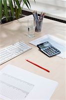 Desk of invoice equipment Stock Photo - Premium Royalty-Freenull, Code: 653-03844351