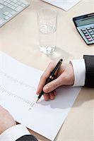 Invoice totaling Stock Photo - Premium Royalty-Freenull, Code: 653-03844374