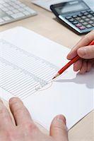 Invoice totaling Stock Photo - Premium Royalty-Freenull, Code: 653-03844383