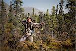 Male bow hunter aims with a compound bow while bow hunting in a Black Spruce forest in the Eklutna Lake area, Chugach Mountains, Chugach State Park, Southcentral Alaska, Autumn Stock Photo - Premium Rights-Managed, Artist: AlaskaStock, Code: 854-03845011