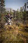 Male bow hunter aims with a compound bow while bow hunting in a Black Spruce forest in the Eklutna Lake area, Chugach Mountains, Chugach State Park, Southcentral Alaska, Autumn Stock Photo - Premium Rights-Managed, Artist: AlaskaStock, Code: 854-03845012