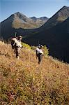 Two male moose hunters carry their trophy moose antlers as they hike out from his hunt in the Bird Creek drainage area, Chugach National Forest, Chugach Mountains, Southcentral Alaska, Autumn Stock Photo - Premium Rights-Managed, Artist: AlaskaStock, Code: 854-03845048