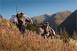 Two male moose hunters carry their trophy moose antlers as they hike out from his hunt in the Bird Creek drainage area, Chugach National Forest, Chugach Mountains, Southcentral Alaska, Autumn Stock Photo - Premium Rights-Managed, Artist: AlaskaStock, Code: 854-03845050
