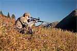 Male moose hunter sits on a hillside and aims with a rifle, Bird Creek drainage area, Chugach Mountains, Chugach National Forest, Southcentral Alaska, Autumn Stock Photo - Premium Rights-Managed, Artist: AlaskaStock, Code: 854-03845079