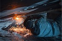 professional (pertains to traditional blue collar careers) - Worker cuts metal fittings off a boat hull using an oxy-acetylene cutting torch, Kodiak Boatyard, Saint Herman Harbor, Kodiak, Near Island, Southwest Alaska, Autumn Stock Photo - Premium Rights-Managednull, Code: 854-03845280
