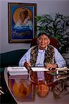 Portrait of a male Inupiaq Eskimo businessman sitting at an office conference table wearing his seal skin vest in Barrow, Arctic Alaska, Summer Stock Photo - Premium Rights-Managed, Artist: AlaskaStock, Code: 854-03845476