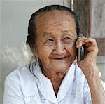 Elderly Thai woman on phone Stock Photo - Premium Royalty-Free, Artist: Asia Images, Code: 621-03846168