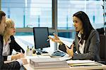 Female executive talking to colleagues Stock Photo - Premium Royalty-Free, Artist: Sheltered Images, Code: 632-03848075