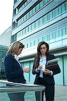 Colleague taking coffee and smoke break outdoors Stock Photo - Premium Royalty-Freenull, Code: 632-03848204
