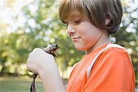 Boy Holding Frog Stock Photo - Premium Royalty-Freenull, Code: 600-03848736