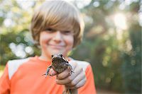 Boy Holding Frog Stock Photo - Premium Royalty-Freenull, Code: 600-03848737