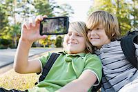 Boys taking Picture with Camera Phone Stock Photo - Premium Royalty-Freenull, Code: 600-03848739