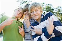 Boys Making Hand Gestures Stock Photo - Premium Royalty-Freenull, Code: 600-03848741