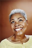 Portrait of Smiling Woman Looking Up Stock Photo - Premium Rights-Managednull, Code: 700-03848888