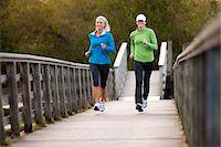 Two Women Jogging through Park Stock Photo - Premium Royalty-Freenull, Code: 600-03849008