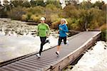 Two Women Jogging through Park Stock Photo - Premium Royalty-Free, Artist: Ty Milford, Code: 600-03849011